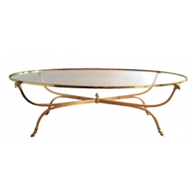 a stylish and good quality french mid-century modern brass oval coffee table with glass top; by maison jansen, paris