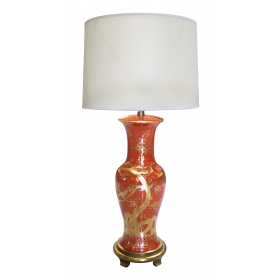 a tall and striking american 1960's orange-red porcelain baluster-form lamp with hand painted gilt decoration; by marbro company, los angeles