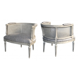 stylish pair of hollywood regency 1960's painted barrel-back chairs with caned back
