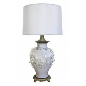 a superb and large german nymphenburg porcelain blanc de chine reticulated lamp with applied floral swag and gilt-bronze mounts