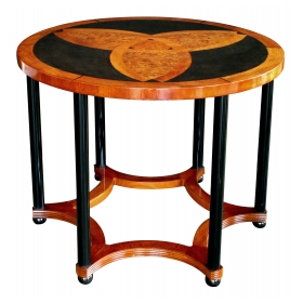 a sophisticated austrian art deco amboyna inlaid circular table with ebonized supports