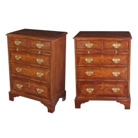a handsome and good quality pair of english george ii style burl walnut 5-drawer bedside chests with brush slides