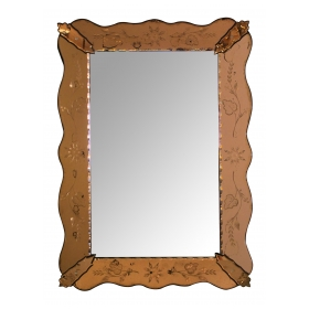 a shapely italian 1930's mirror with etched peach-colored surround