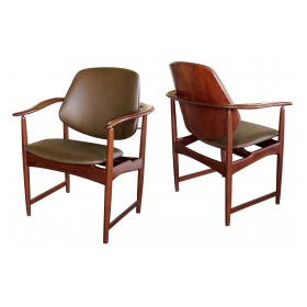 a mod pair of danish arne hovman-olsen 1960's teak armchairs with leather upholstery