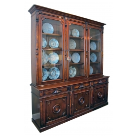 a large and well-constructed two-piece american renaissance revival walnut bookcase