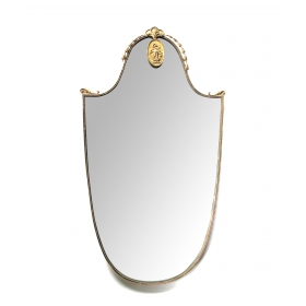 a chic italian 1950's gilt-bronze shield-form mirror
