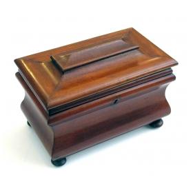 a shapely english victorian bombe-form mahogany tea caddy on bun feet