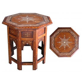 an intricately inlaid octagonal anglo-indian traveling table