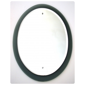 the beveled oval plate of thick, heavy mirror within a smoky raw umber mirrored border; no chips or cracks; minor wear