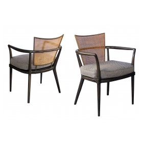 a stylish pair of american mid-century walnut arm chairs with cane and brass back; by bert england for johnson furniture