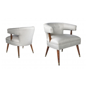 a stylish pair of american mid-century barrel-back upholstered arm chairs