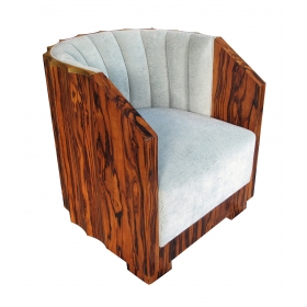 exceptional and shapely austrian art deco black walnut-veneered barrel-back club chair with scalloped frame