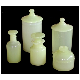 a luminous set of Murano Cenedese mid-century vessels of pale chartreuse opaline glass