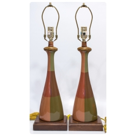 a handsome pair of american orange and olive green ceramic bottle-form lamps