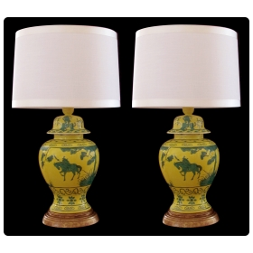 a stunning and richly-colored pair of mid-century chinese canary yellow ginger jars with dark green decoration now mounted as lamps