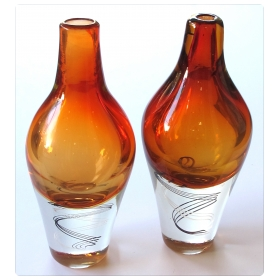 exceptional pair of Kosta Boda Swedish orange art glass vases; designed by Klas-Goran Tinback