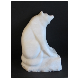 large-scaled and expressive carved marble figure of a seated red panda bear with its distinctive puffy tail