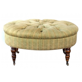 handsome english late 19th century oval ottoman/stool with turned legs and casters