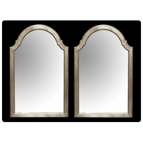a shapely pair of english queen anne silver-leafed giltwood mirrors