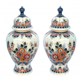well-executed pair of delft polychromed hand-painted covered jars signed by the artist P. Verhoeve