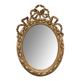 A French Napoleon III Giltwood and Composite Oval Mirror with Ribbon Crest and Oak Leaf Border