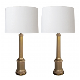 a good and stylish pair of hollywood regency mid-century columnar tan cased-glass lamps by paul hanson