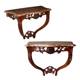 a charming pair of french louis xv carved walnut serpentine-form wall consoles with  breche d'alep tops