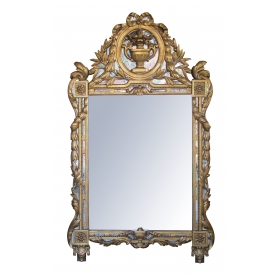 a striking and exuberantly carved french regence style carved gilt-wood mirror