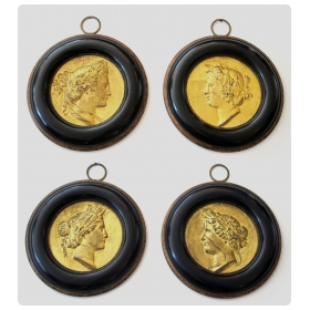 a classicaly-inspired set of four french gilt-metal circular relief medallions depicting the four seasons