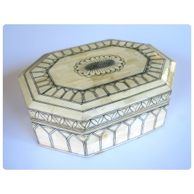 intricately decorated moroccan octagonal bone box with hinged lid