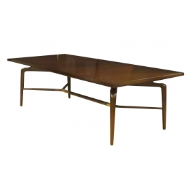 sleek and long Monteverdi Young mid-century rectangular walnut dining table with 2 leaves