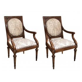 an exquisite and large-scaled pair of italian neoclassical carved walnut upholstered arm chairs