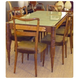a distinctive italian 1940's dining table and six chairs designed by Pier Luigi Colli