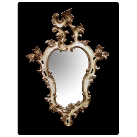 a fanciful venetian rococo revival ivory painted and parcel-gilt cartouche-shaped mirror