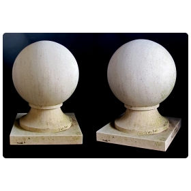 a massive and stately pair of french carved limestone orb-form garden elements