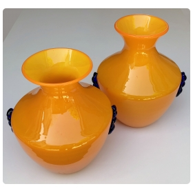 a rare pair of blenko orange glass vases with applied cobalt decoration
