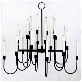 a stylish 1960's black enameled metal 12-arm candelabra style chandelier attributed to Tommi Parzinger