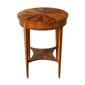well-crafted and richly-grained english edwardian matchbook-veneered circular single-drawer side table