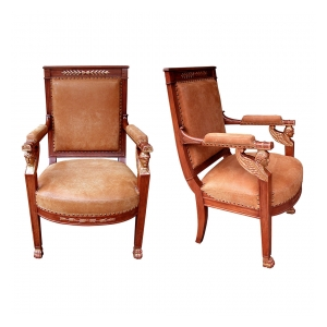 a good pair of french empire fruitwood and parcel-gilt armchairs with sphinx-head motifs