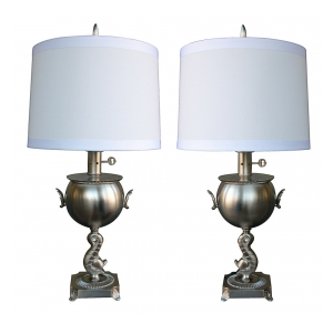 a stylish pair of american art deco brushed-nickel plated lamps with dolphin support
