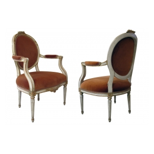 pair of swedish gustavian style ivory painted and parcel-gilt oval-back armchairs
