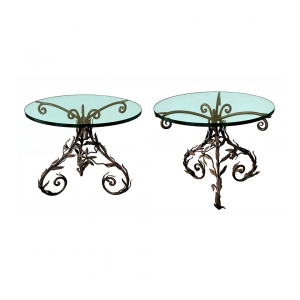 a lively pair of italian wrought iron circular tripod side Tabless with foliate decoration and glass tops