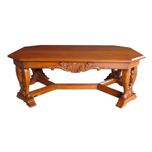 a handsome and boldly-carved french baroque style cherrywood coffee table with canted corners
