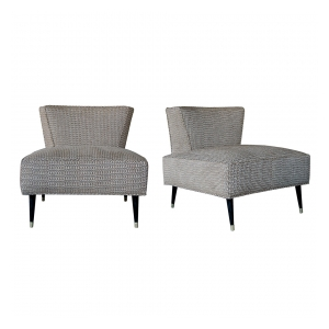 a stylish and generously-proportioned pair of american mid-century wedge-back chairs