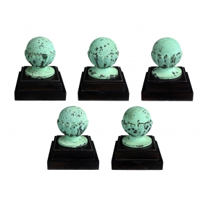 a well-patinated set of five american classical-revival verdigris bronze architectural spheroid finials