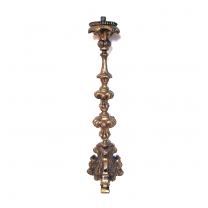 a boldly-scaled italian baroque carved giltwood candlestick