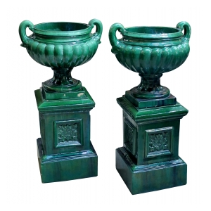 a large and handsome pair of english classical revival emerald green glazed double-handled urns on stand