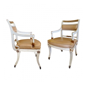 a stylish pair of 1940's hollywood regency ivory-painted and parcel-gilt klismos armChairss