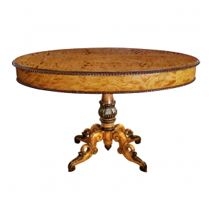 a warmly patinated swedish biedermeier oval birch center table with ebonized highlights