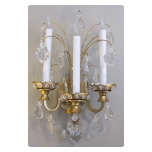 an elegant pair of french 1940's gilt-tole and crystal 3-arm wall sconces by maison jansen